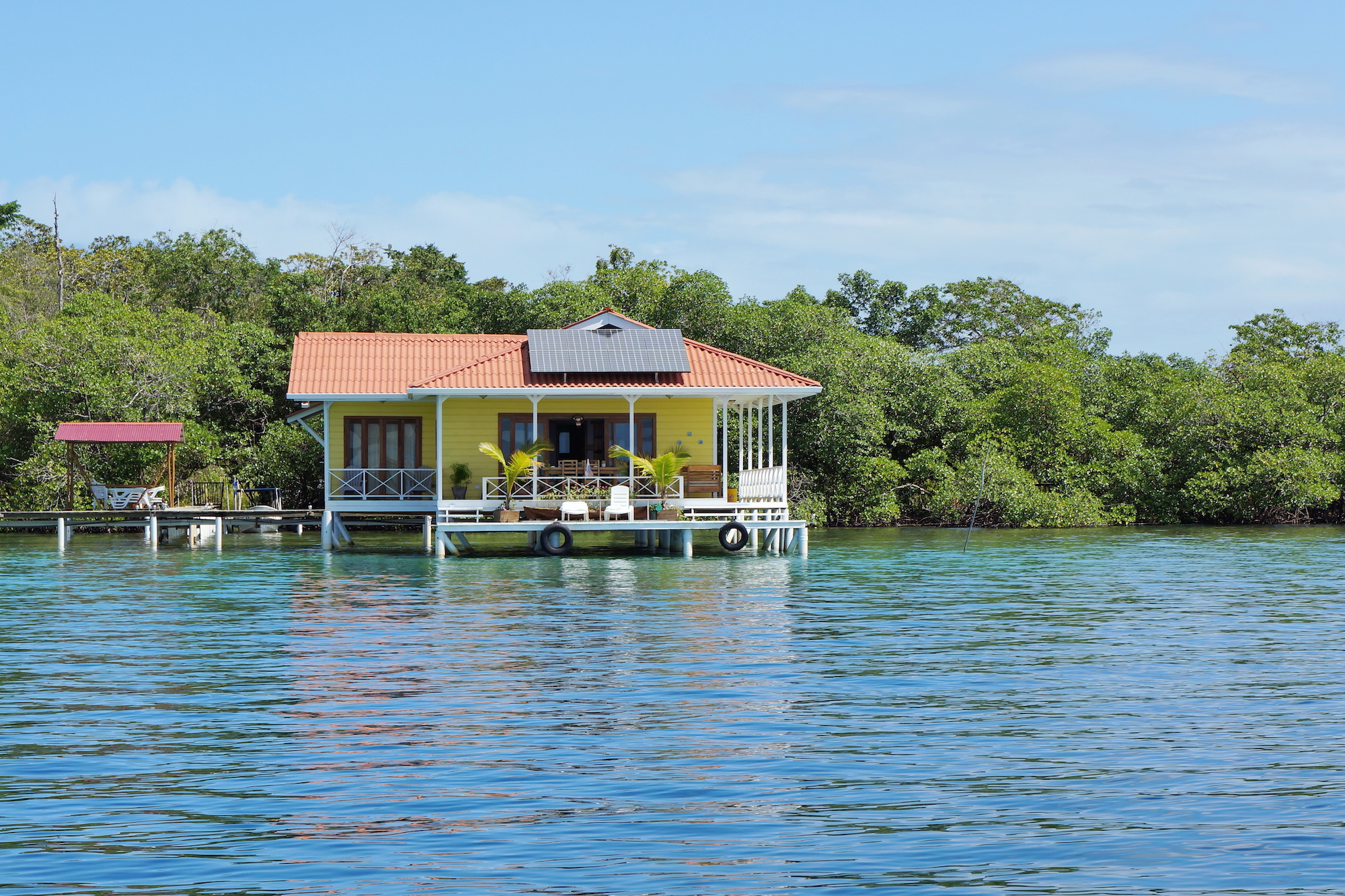 Off-grid house over the sea with solar panels